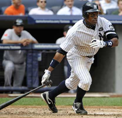 Curtis Granderson smacks a pair of doubles and drives in three runs to lead the Yanks past the Blue Jays. (AP)