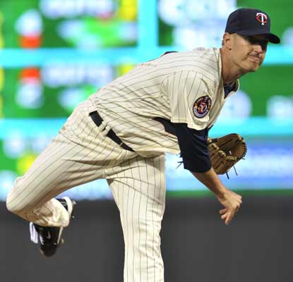 Matt Fox looks good for the Twins in his MLB debut, throwing 5 2/3 innings to help his team edge out the Rangers.  (AP)