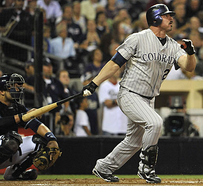 Jason Giambi's homer in the second inning accounts for two of Colorado's four runs. (AP)