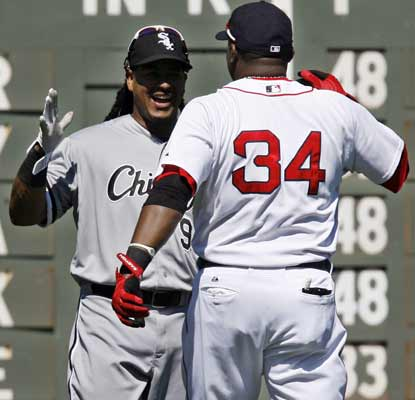 Manny Ramirez and David Ortiz catch up on old times before Ramirez singles twice in the game to help the ChiSox down Boston.  (AP)