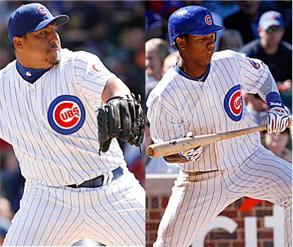 Carlos Zambrano (left) whiffs eight and yields just four hits while Starlin Castro makes Cubs history with his two hits. (AP)