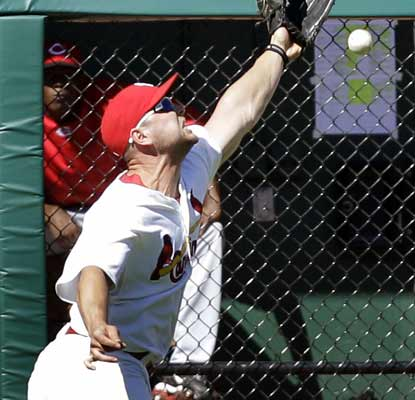 Matt Holliday lets one sail over his head as the Cardinals lose 6-1 in a crucial game against the Reds.  (AP)