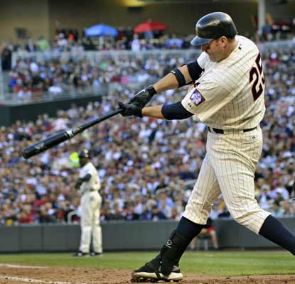 Jim Thome watches the first of two HRs fly out of the park as he surpasses Mark McGwire on the all-time HR list. (AP)
