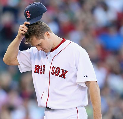 Jonathan Papelbon is left scratching his head after blowing the save with just one out to go.  (Getty Images)