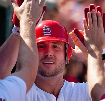 Matt Holliday meets the welcoming party in the dugout after he blasts his 25th homer of the season.  (Getty Images)