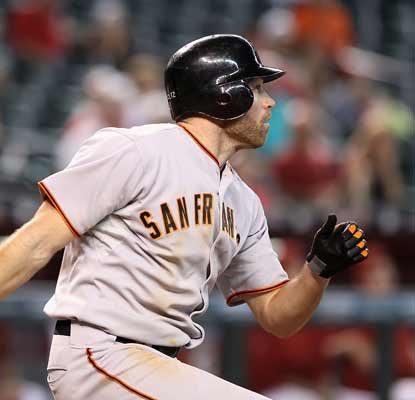 Nate Schierholtz hits a two-run triple off Aaron Heilman in the 11th to accelerate the Giants past the Diamondbacks.  (AP)