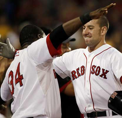 Ryan Kalish jogs into the open arms of David Ortiz after knocking a grand slam to help the BoSox dominate the Rays. (AP)