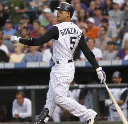 And the hits just keep on comin' for Carlos Gonzalez, who watches a HR fly out as the Rockies defeat the Reds.  (AP)