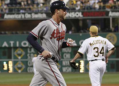 Despite giving up eight hits, Derek Lowe -- who scores a run here -- defeats Pittsburgh for the 10th straight time. (AP)