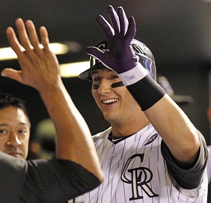 Troy Tulowitzki is all smiles with his two-homer night to help keep the Rockies red hot.  (AP)
