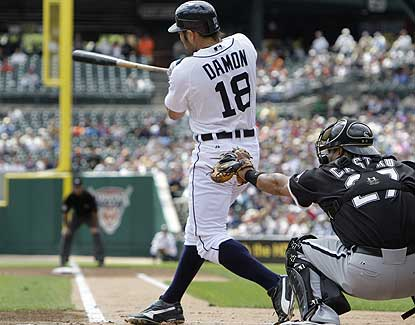 Johnny Damon has a season-high four hits as Detroit drops Chicago six games back for the AL Central lead. (AP)