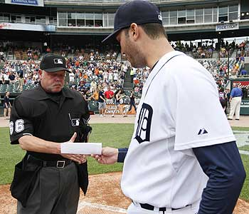 Umpire Jim Joyce made nice with Armando Galarraga after admitting he denied the Tigers pitcher a piece of history. (AP)