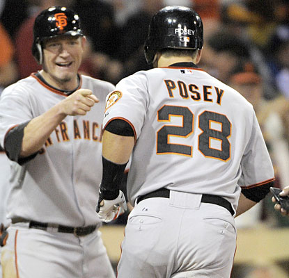 Aubrey Huff and Buster Posey play key roles in the Giants win, each hitting two-run homers.  (AP)