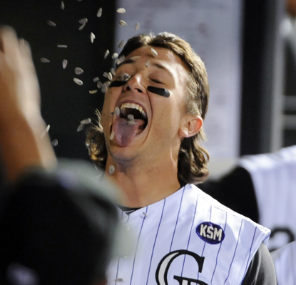 Troy Tulowitzki is congratulated in the dug out with a shower of sunflower seeds after hitting a solo HR. (AP)