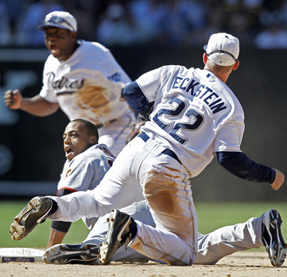 The Padres' David Eckstein and Miguel Tejada celebrate after turning a double play to end the game against the Giants.  (AP)