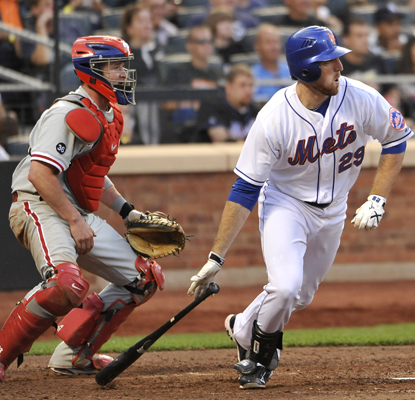 Ike Davis' two-run single in the seventh proves to be the game's difference maker as the Mets slow the surging Phils.  (AP)