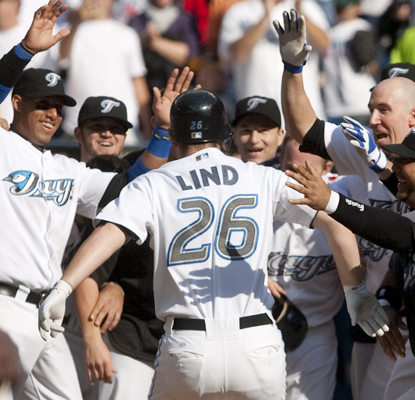Members of the Toronto Blue Jays wait for teammate Adam Lind following his walk-off HR in the bottom of the ninth.  (AP)