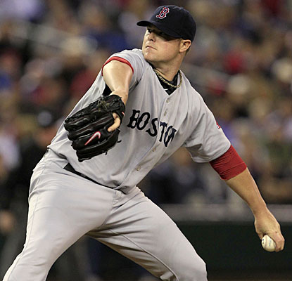 Jon Lester allows three hits in eight innings to pick up his 17th win of the season.  (AP)