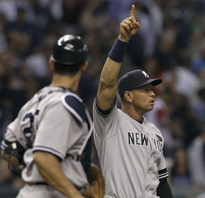 Alex Rodriguez celebrates with Jorge Posada after the Yanks' win over the Rays propels them back into first place in the East. (AP)