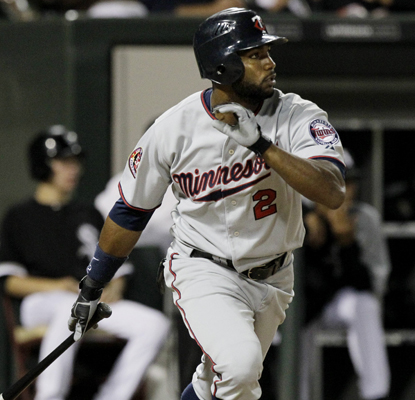 The Twins' Denard Span watches his three-run double off White Sox reliever J.J. Putz during the eighth inning.  (AP)