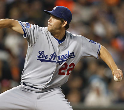 Dodgers left-hander Clayton Kershaw claims his first career complete game shutout as he four-hits the Giants. (AP)