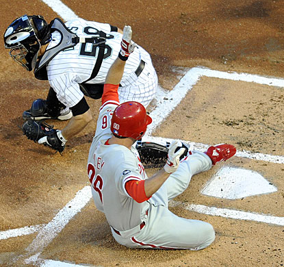 Marlins catcher Brad Davis is late with the tag as Chase Utley slides in to score. (US Presswire)