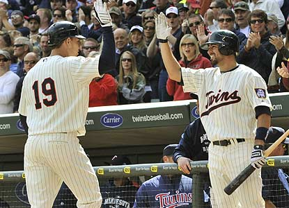 Danny Valencia (left), who's hitting .431 with RISP, helps the Twins move closer to clinching the AL Central. (AP)