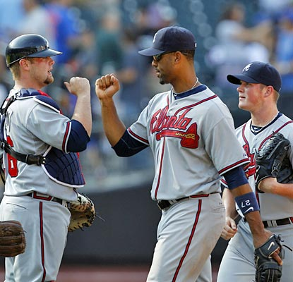 Derrek Lee is the toast of the team on this day with his clutch grand slam to lift the Braves.  (AP)