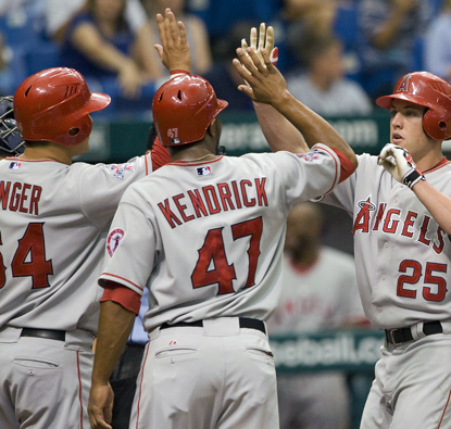 Peter Bourjos is congratulated by his teammates after knocking a three-run home run during the fourth. (AP)