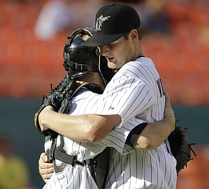 Catcher Brad Davis, who hit a grand slam, congratulates Chris Volstad after the Marlins right-hander's second career shutout.  (AP)