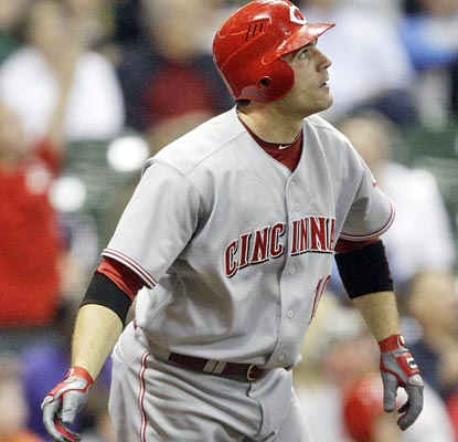 Joey Votto watches his shot sail over the fence in the first of back-to-back home runs for the Reds.  (AP)