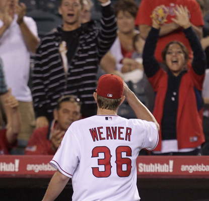 Jered Weaver tips his hat to an appreciative home crowd as he walks off the field after being relieved in seventh inning.  (AP)