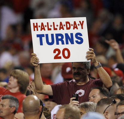 Fans celebrate Roy Halladay¿s 20th win after the Phils beat the Atlanta Braves for the second straight night.   (Getty Images)