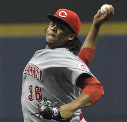 The Reds' Edinson Volquez allows just one run over eight innings to help his team hold off the Brewers.  (AP)