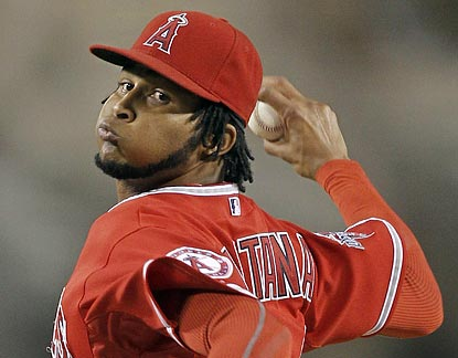 Ervin Santana scatters five singles and strikes out eight in earning his career-high 17th victory.  (AP)