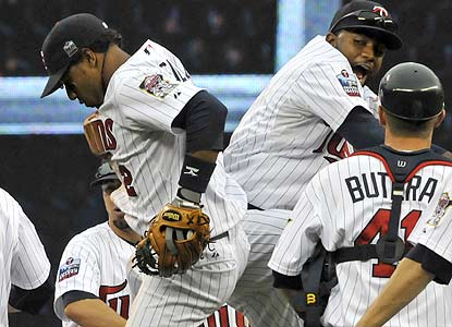A day after becoming the first to punch their playoff ticket, the Twins finish off the Indians for good measure. (AP)