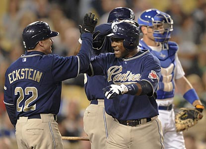 David Eckstein congratulates Miguel Tejada on his 300th home run, a two-run shot that caps San Diego's three-run third inning.  (AP)