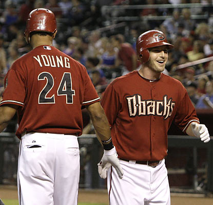 D-Backs shortstop Stephen Drew is all smiles as he crosses the plate following his solo shot in the first off Ubaldo Jimenez. (AP)