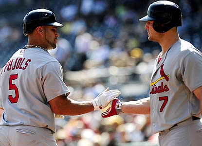 Albert Pujols hits his 40th and 41st  homers while Matt Holliday records his third 100-RBI season for St. Louis. (AP)