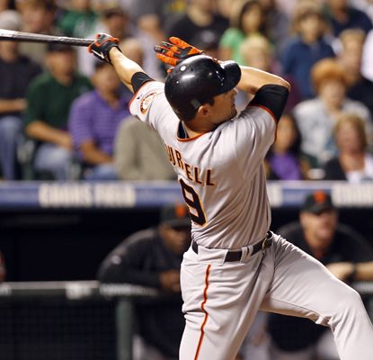 Pat Burrell's two run shot proves to be the difference maker in the Giants' win over the Rockies.  (Getty Images)