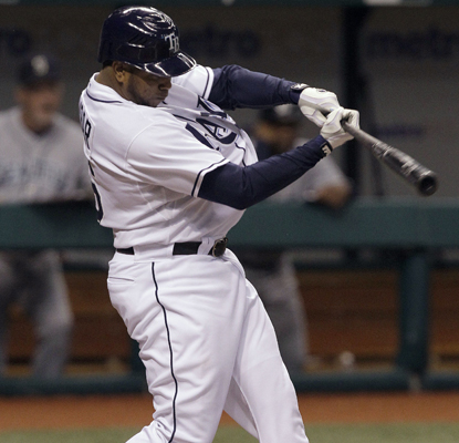 Willy Aybar lines a fifth-inning RBI single off the Mariners' Jason Vargas. (Getty Images)