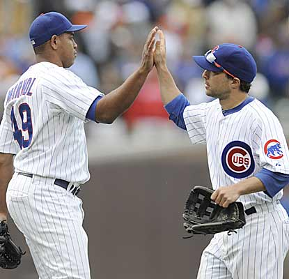 Carlos Marmol and Sam Fuld (right), celebrate after defeating the Cardinals with Fuld's go-ahead single. (AP)