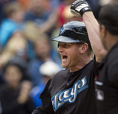 Lyle Overbay enjoys his walk-off homer in the 11th inning, the fourth dinger of the game for Toronto. (AP)