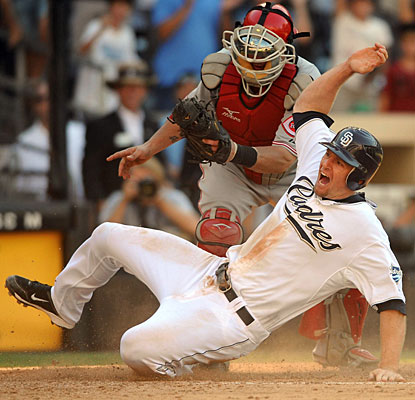 Chase Headley slides for the game-winning run on the hit by Chris Denorfia. (US Presswire)