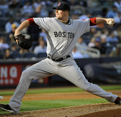 Jon Lester overpowers the Yankees to help the Red Sox close within 5 ½ games of New York for the AL wild-card. (AP)