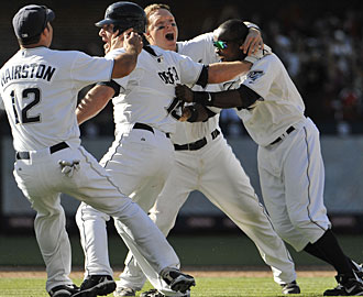 The Padres celebrate another win toward their goal of making the playoffs. (AP)
