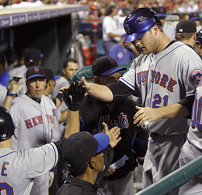 Rookie pinch-hitter Lucas Duda is greeted by teammates following his key three-run double in the seventh.  (AP)