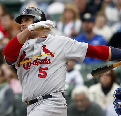 Albert Pujols hits his league-leading 42nd HR -- a three-run shot -- during the first inning against the Cubs. (US Presswire)