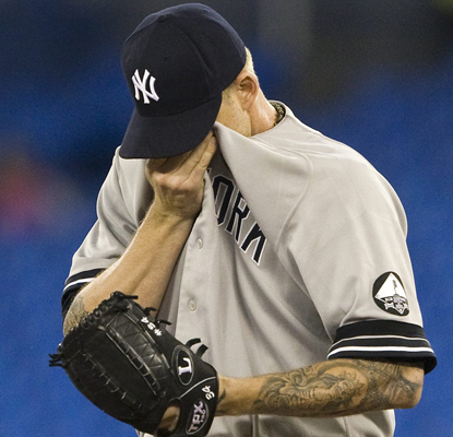 The Yankees' A.J. Burnett reacts after giving up a three-run HR to the Jays' John Buck.   (AP)