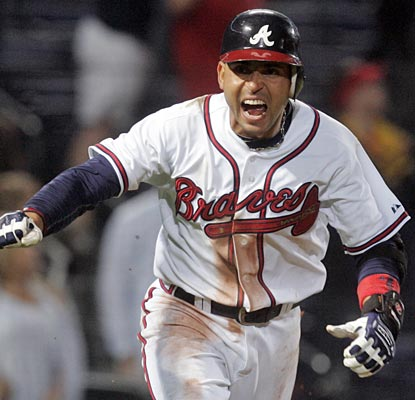 Think the Braves' Omar Infante is happy with his game-winning single in the 11th inning?  (AP)